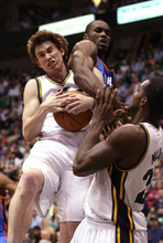 Leah Hogsten  |  The Salt Lake Tribune The Jazz's Gordon Hayward grabs the rebound beforeThunder's Serge Ibaka.  Utah Jazz lead 52-44 after the first half against Oklahoma City Thunder, Tuesday, March 20, 2012, at the Energy Solutions Arena in Salt Lake City, Utah .