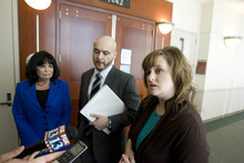 Paul Fraughton | The Salt Lake Tribune Rob Manzanares and his mother, Elizabeth, stand next to their attorney Jennifer Reyes, right, after a Wednesday hearing on the custody of Rob Manzanares' daughter, given up at birth without his consent.