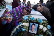 Natalia Andres Lopez,  left, and another relative, mourn over the coffin containing the body of her cousin, after the identification and repatriation of the remains from Mexico at an Air Force base in Guatemala City , Wednesday, March 21, 2012.  According to Mexican authorities, Castro was one of  72 migrants allegedly executed Aug. 25, 2010 by the Zetas drug cartel in the northeastern Mexico town of San Fernando, just 100 miles from the U.S. border. (AP Photo/Rodrigo Abd)