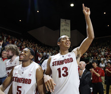 Stanford forward Josh Owens (13) and guard Chasson Randle (5) celebrate after Stanford defeated Nevada 84-56 in a college basketball game in the NIT quarterfinals, Wednesday, March 21, 2012, in Stanford, Calif. (AP Photo/Paul Sakuma)