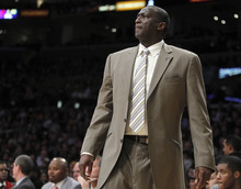 Utah Jazz head coach Tyrone Corbin on the sidelines playing against the Los Angeles Lakers during the first half of an NBA basketball game in Los Angeles, Sunday, March 18, 2012. (AP Photo/Alex Gallardo)