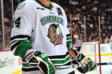 In this photo taken March 15, 2012, a North Dakota hockey player is shown between periods of a WCHA college hockey tournament game in St. Paul, Minn. The hockey team will wear new jerseys this weekend in the NCAA college hockey regionals in St. Paul, Minn., since the NCAA won't allow the nickname or the American Indian logo to be displayed during postseason play. (AP Photo/Bre McGee)
