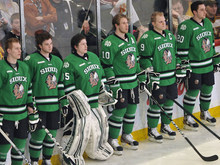In this photo taken March 16, 2012 photo, North Dakota hockey pl;ayers wait during introductions while wearing where their Fighting Sioux logo jerseys at a WCHA college hockey tournament game in St. Paul, Minn. The hockey team will wear new jerseys this weekend in the NCAA college hockey regionals in St. Paul, Minn., since the NCAA won't allow the nickname or the American Indian logo to be displayed during postseason play. (AP Photo/Jim Mone)