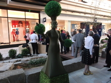 Sean P. Means  |  The Salt Lake Tribune What am I, a potted plant? A model stands motionless as a planter during Wednesday's charity gala at City Creek Plaza.