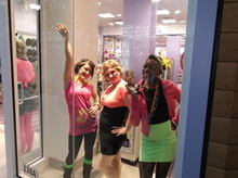 Sean P. Means  |  The Salt Lake Tribune Neon-clad employees at Claire's Accessories dance and strike poses in the store window during Wednesday's charity gala at City Creek Plaza.
