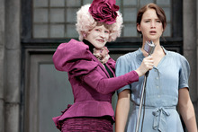 In this image released by Lionsgate, Elizabeth Banks portrays Effie Trinket, left, and Jennifer Lawrence portrays Katniss Everdeen in a scene from