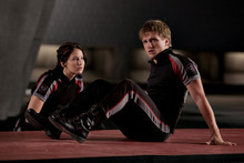In this image released by Lionsgate, Jennifer Lawrence portrays Katniss Everdeen, left, and Josh Hutcherson portrays Peeta Mellark in a scene from