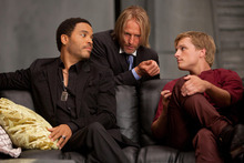 In this image released by Lionsgate, from left, Lenny Kravitz portrays Cinna, Woody Harrelson portrays Haymitch Abernathy and Josh Hutcherson portrays Peeta Mellark in a scene from