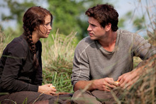 In this image released by Lionsgate, Jennifer Lawrence portrays Katniss Everdeen, left, and Liam Hemsworth portrays Gale Hawthorne in a scene from