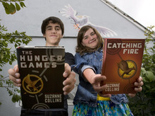 Steve Griffin  |  The Salt Lake Tribune  In this archive photo from August 2010, George and Emma Metos hold copies of their books in Suzanne Collins'