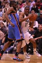 Leah Hogsten  |  The Salt Lake Tribune Jazz's Alec Burks rounds the hip of the Thunder's James Harden.  Utah Jazz lead 52-44 after the first half against Oklahoma City Thunder, Tuesday, March 20, 2012, at the Energy Solutions Arena in Salt Lake City, Utah .