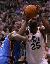 Leah Hogsten  |  The Salt Lake Tribune Utah Jazz's Al Jefferson battles the Thunder's Kendrick Perkins during the first half against Oklahoma City Thunder, Tuesday, March 20, 2012, at the Energy Solutions Arena in Salt Lake City, Utah .