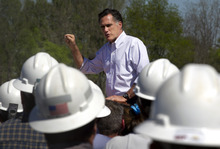 Republican presidential candidate, former Massachusetts Gov. Mitt Romney, center, speaks to a crowd that includes workers from a natural gas drilling rig during a campaign event near the rig in Shreveport, La., Friday, March 23, 2012.  (AP Photo/Steven Senne)