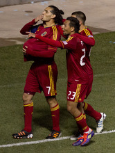 Trent Nelson  |  The Salt Lake Tribune Real Salt Lake's Fabian Espindola (7) puts the ball under his shirt and blows a kiss to his pregnant wife after scoring a first half goal. Real Salt Lake vs. New York Red Bulls, MLS Soccer Saturday, March 17, 2012 at Rio Tinto Stadium in Sandy, Utah.