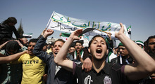 Syrians anti-Bashar Assad slogans in front of the Syrian embassy during a protest in Amman, Jordan, Friday, March 23, 2012. The Arabic banner reads,