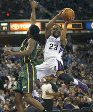 Sacramento Kings guard Marcus Thornton (23) drives to the basket against Utah Jazz defender DeMarre Carroll during the second half of an NBA basketball game in Sacramento, Calif., Thursday, March 22, 2012. The Jazz won 103-102.(AP Photo/Steve Yeater)
