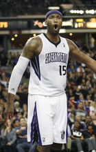 Sacramento Kings center DeMarcus Cousins reacts to an official's foul call during the second half of an NBA basketball game against the Utah Jazz in Sacramento, Calif., Thursday, March 22, 2012. The Jazz won 103-102.(AP Photo/Steve Yeater)