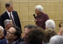 Kim Raff | The Salt Lake Tribune (right) James Harris asks a question of MTC director Richard Heaton during a neighborhood meeting at Rock Canyon Elementary School in Provo to discuss building a new nine-story MTC building  on March 22, 2012.