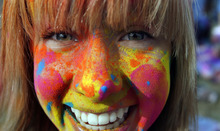 Francisco Kjolseth  |  The Salt Lake Tribune Liz Evens, 14, of Alpine somehow manages to keep her teeth clean as she joins the party moving to the music with bright colorful chalk made of edible maize flies during Holi, the Festival of Colors at Sri Radha Krishna Temple in Spanish Fork on Saturday, March 24, 2012. Thousands packed the temple grounds to celebrate Holi, the traditional Indian announcement of the arrival of spring and the passing of winter. The festival continues Sunday.