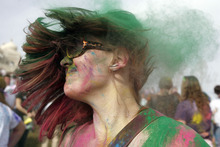 Francisco Kjolseth  |  The Salt Lake Tribune Trisha Dawn of Midvale puts on some color as she joins thousands dancing to the music as they throw bright colorful chalk made of edible maize during Holi, the Festival of Colors at Sri Radha Krishna Temple in Spanish Fork on Saturday, March 24, 2012. Thousands packed the temple grounds to celebrate Holi, the traditional Indian announcement of the arrival of spring and the passing of winter. The festival continues Sunday.