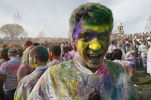 Francisco Kjolseth  |  The Salt Lake Tribune Jeff Derricott of Bountiful joins revelers as they dance to the music throwing bright colorful chalk made of edible maize during Holi, the Festival of Colors at Sri Radha Krishna Temple in Spanish Fork on Saturday, March 24, 2012. Thousands packed the temple grounds to celebrate Holi, the traditional Indian announcement of the arrival of spring and the passing of winter. The festival continues Sunday.