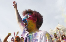 Francisco Kjolseth  |  The Salt Lake Tribune Preston Hale of Provo dances to the music as thousands throw bright colorful chalk made of edible maize during Holi, the Festival of Colors at Sri Radha Krishna Temple in Spanish Fork on Saturday, March 24, 2012. Thousands packed the temple grounds to celebrate Holi, the traditional Indian announcement of the arrival of spring and the passing of winter. The festival continues Sunday.