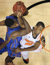 Louisville's Russ Smith, left, and Florida's Casey Prather battle for the ball during the first half of an NCAA tournament West Regional final college basketball game, Saturday, March 24, 2012, in Phoenix. Louisville won the game 72-68.  (AP Photo/Chris Carlson)