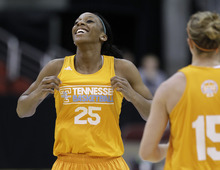 Tennessee forward Glory Johnson jokes with teammates during basketball practice, Friday, March 23, 2012, in Des Moines, Iowa.  Tennessee plays Kansas in an NCAA women's tournament regional semifinal college basketball game on Saturday. (AP Photo/Charlie Neibergall)