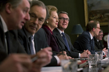 Meryl Streep (center) plays Margaret Thatcher, with cabinet member Geoffrey Howe (Anthony Head), in