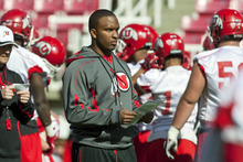 Chris Detrick  |  The Salt Lake Tribune Utah offensive coordinator Brian Johnson watches practice at Rice-Eccles Stadium Tuesday March 20, 2012.