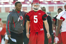 Chris Detrick  |  The Salt Lake Tribune Utah offensive coordinator Brian Johnson talks with quarterback Chase Hansen practice at Rice-Eccles Stadium Tuesday March 20, 2012.