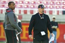 Chris Detrick  |  The Salt Lake Tribune Utah offensive coordinator Brian Johnson and head coach Kyle Whittingham watch practice at Rice-Eccles Stadium Tuesday March 20, 2012.