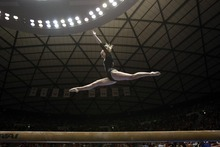 Chris Detrick  |  The Salt Lake Tribune Mary Beth Lofgren competes on the beam during the gymnastics meet against Utah State at the Huntsman Center Friday January 13, 2012.