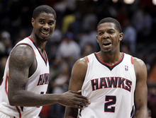 Atlanta Hawks' Joe Johnson, right, and Marvin Williams celebrate in the finals second of quadruple overtime of an NBA basketball game against the Utah Jazz on Sunday, March 25, 2012, in Atlanta. Atlanta won 139-133. (AP Photo/David Goldman)