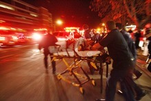 Danny Chan La  |  Tribune file photo A victim of the shootings at Trolley Square is moved to an ambulance Feb. 12, 2007.