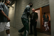 Leah Hogsten  |  The Salt Lake Tribune Jazz player Al Jefferson greets Chaplain Jerry Lewis of The Point Christian Church as fellow player Earl Watson follows behind.  Several Utah Jazz players attend a pregame chapel session on the arena floor-level of EnergySolutions Arena, Tuesday March 20, 2012, prior to their game against the Oklahoma City Thunder.