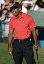 Tiger Woods celebrates after winning the Arnold Palmer Invitational golf tournament at Bay Hill in Orlando, Fla., Sunday, March 25, 2012. (AP Photo/Phelan M. Ebenhack)