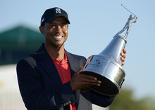 Tiger Woods hoists the championship trophy after winning the Arnold Palmer Invitational golf tournament at Bay Hill in Orlando, Fla., Sunday, March 25, 2012. (AP Photo/Phelan M. Ebenhack)