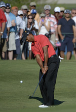 Tiger Woods chips onto the 14th green during the final round of the Arnold Palmer Invitational golf tournament at Bay Hill in Orlando, Fla., Sunday, March 25, 2012.(AP Photo/Phelan M. Ebenhack)