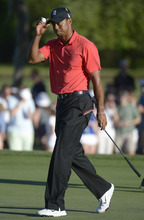 Tiger Woods acknowledges the crowd after making a putt for par on the 17th green during the final round of the Arnold Palmer Invitational golf tournament at Bay Hill in Orlando, Fla., Sunday, March 25, 2012.(AP Photo/Phelan M. Ebenhack)