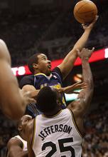Trent Nelson  |  The Salt Lake Tribune Denver's Andre Miller shoots over Utah Jazz center/forward Al Jefferson (25). Utah Jazz vs. Denver Nuggets, NBA basketball Friday, March 23, 2012 at EnergySolutions Arena in Salt Lake City, Utah.
