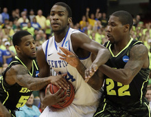 Kentucky's Michael Kidd-Gilchrist (14) works against Baylor's Pierre Jackson, left, and Baylor's A.J. Walton (22) during the first half of an NCAA tournament South Regional finals college basketball game Sunday, March 25, 2012, in Atlanta. (AP Photo/David J. Phillip)