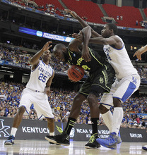 Baylor's Quincy Acy (4) works against Kentucky's Marquis Teague (25) and Kentucky's Michael Kidd-Gilchrist right,, during the first half of an NCAA tournament South Regional finals college basketball game Sunday, March 25, 2012, in Atlanta. (AP Photo/John Bazemore)