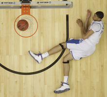 Kentucky's Anthony Davis (23) hits the floor after dunking the ball against Baylor  during the first half of an NCAA tournament South Regional finals college basketball game Sunday, March 25, 2012, in Atlanta. (AP Photo/John Bazemore)