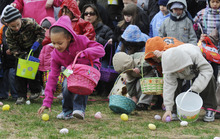 In an April 23, 2011 photo, children dash to collect as many eggs as possible at the Old Colorado City Easter Egg Hunt on in Colorado Springs Colo. Organizers have canceled this year's event, complaining of parental behavior. They say that last year aggressive parents swarmed into a tiny Colorado Springs park last year, determined that their kids get an egg.  (AP Photo/The Colorado Springs Gazette, Jerilee Bennett)