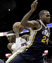 Atlanta Hawks' Josh Smith, left, grabs a rebound from Utah Jazz's Paul Millsap during the first quarter of an NBA basketball game Sunday, March 25, 2012, in Atlanta. (AP Photo/David Goldman)