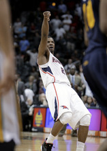Atlanta Hawks' Joe Johnson watches his shot go in for two points in the final seconds of quadruple overtime of an NBA basketball game against the Utah Jazz on Sunday, March 25, 2012, in Atlanta. Atlanta won 139-133. (AP Photo/David Goldman)