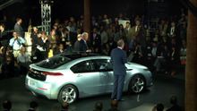 Courtesy photo GM's Bob Lutz shows off the Chevy Volt to the press, in a scene from the documentary
