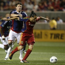 Rick Egan  | The Salt Lake Tribune   Real Salt Lake's Fabian Espindola (7)  goes for the ball, as Heath Pearce defends for Chivas USA, in MLS soccer action in Sandy, Saturday, March 24, 2012.