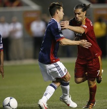 Rick Egan  | The Salt Lake Tribune   Real Salt Lake's Fabian Espindola (7)  troes to get by Chiva's USA's  Heath Pearce, in MLS soccer action in Sandy, Saturday, March 24, 2012.